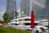 LONDON UK - MAY 7, 2014  Private yacht based in Canary Wharf, against modern office buildings