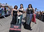 Three Iron Mermaidens posing on boardwalk