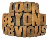 look beyond obvious in wood type - isolated text in fisheye lens perspective in vintage letterpress