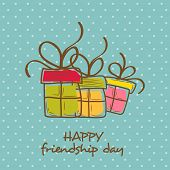 Colorful gift boxes on dots green background for Happy Friendship Day celebrations.