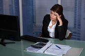 stock photo of late 20s  - Stressed young businesswoman working at computer desk in office - JPG