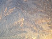 Frosty patterns on window in winter.