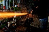 Chopping Metal Worker In The Factory