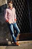 Male Model Leaning Against Wall
