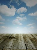 Wooden floor leading to blue sky