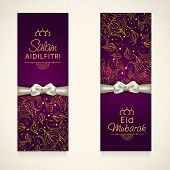 Beautiful floral decorated banner design with silver ribbons for Muslim community festival Eid Mubarak celebrations.