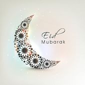 Crescent moon decorated with flowers on shiny colourful background for muslim community festival Eid Mubarak celebrations.