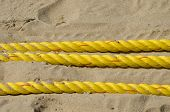 Yellow Ropes On Resort Beach Sand