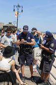 NYPD officers writing ticket for alcohol-related offense at Coney Island Boardwalk  in Brooklyn