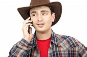 picture of ironic  - Paleface cowboy talking on smartphone with ironic smile on white background - JPG
