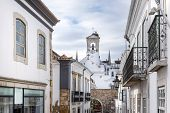 stock photo of faro  - Church tower in historic district of Faro in Portugal - JPG