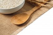 rice cereal and wooden spoon on burlap background. isolate