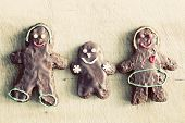 Gingerbread family. Handmade in home, decorated by children. Vintage Christmas