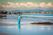 Beach Vacation. Girl Walking Along A Beach In The Spain
