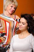 Hairdresser Making Hair Of Beautiful Girl