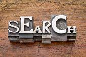 search  word in mixed vintage metal type printing blocks over grunge wood