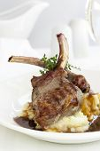 Lamb cutlets with mashed potato and gravy.