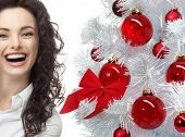 closeup portrait of attractive  caucasian smiling woman brunette isolated on white studio shot lips toothy smile face hair head and shoulders looking at camera tooth christmas tree new year