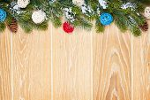 Christmas wooden background with snow fir tree, decor and copy space