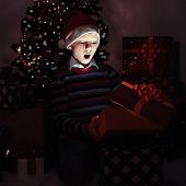 Surprised Boy Opening A Present Box.