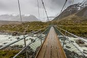 stock photo of hookers  - Bridge over Hooker River in Aoraki national park New Zealand - JPG