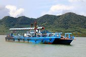 KRABI, THAILAND - MAY 2014 : People using local ferry to transport vehicles from Ko Lanta Island to mainland on 15 May 2014 in Ko Lanta District in Krabi Province, Thailand