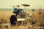 picture of drum-set  - Remote drum set in beautiful warm colors in nature - JPG