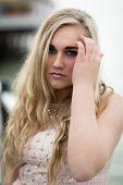 Beautiful Blond Teenage Girl With Blue  Eyes