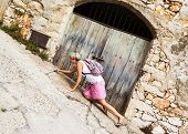 Woman Walking Up The Steep Streets