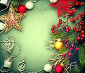 Christmas Decoration frame of Vintage baubles and garland. Christmas background. New Year card design. Sepia toned