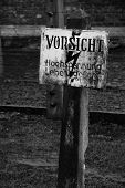 stock photo of auschwitz  - a sign of danger in the death camp in Auschwitz - JPG
