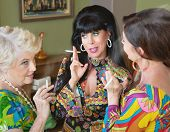 picture of smoking woman  - Group of three 1960s style women gossiping and smoking - JPG