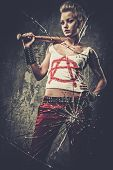 pic of baseball bat  - Punk girl behind broken glass with a baseball bat - JPG