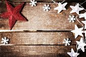 Christmas Rustic Background With Lights, Snowflakes, Stars And Free Text Space. Festive Vintage Plan