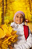 Close up view of African girl with leaves bunch