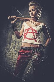 picture of anarchists  - Punk girl behind broken glass with a baseball bat - JPG