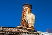 stock photo of shipwreck  - Chimney and ventilation of old passanger shipwreck with blue sky in background - JPG