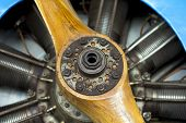 foto of propeller plane  - Old aircraft engine with wood propeller vintage plane close up - JPG