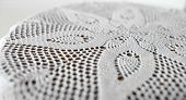 stock photo of doilies  - flower symmetrical pattern lace doily close to - JPG