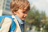 foto of schoolboys  - Portrait of serious schoolboy with backpack outdoor - JPG