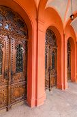 pic of synagogue  - arch enter to old red synagogue with wooden doors - JPG