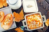 pic of porridge  - pumpkin porridge in the bowl and on a table - JPG