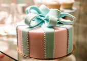 stock photo of eatables  - close up on adorable birthday cake with eatable bow - JPG