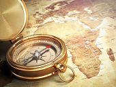 foto of compasses  - Vintage compass on the old world map with DOF effect - JPG