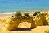 picture of peculiar  - Natural stone arch on Armacao De Pera Beach - JPG