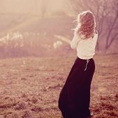 pic of wheat-free  - Portrait of a beautiful blonde girl in the white pullovers standing with his back