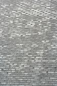 image of roofs  - Home roof surface. House roof tiles. Grey roof tile.