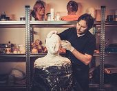 picture of prosthetics  - Men during lifecasting process in a prosthetic special fx workshop - JPG
