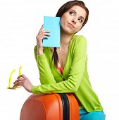 stock photo of boarding pass  - portrait of female tourist with travel suitcase and boarding pass - JPG