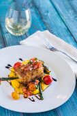 image of pork belly  - Crispy pork belly on kabocha squash puree with tomatoes and asparagus topped with pico de gallo - JPG